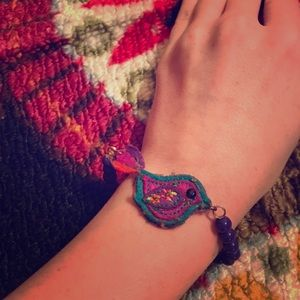 Claire's vibrant colored bird beaded bracelet